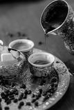 Bosnian coffee. A metallic tray with copper plated cezve filled with traditional foam Bosnian coffee, silver pot with sugar, coffee beans in cups Stock Image