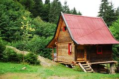 Bosnian Forest Hut. A wooden hut located deep in the Bosnian forest next to a small lake Royalty Free Stock Image