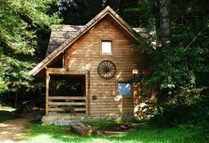 Bosnian Forest Hut. A wooden hut located deep in the Bosnian forest. The words by the logs, 'dobro dosli', mean 'welcome Royalty Free Stock Image