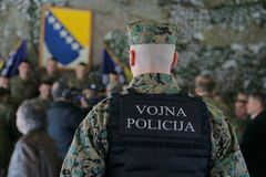 Bosnian Military officer. Protects a group of people Stock Photos