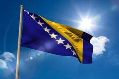 Bosnian national flag on flagpole Stock Photography