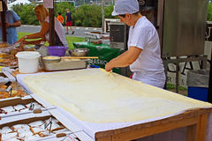 Bosnian rolled burek - spreading the dough Royalty Free Stock Photography