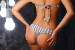 Bosom of model in a gray with white knitted bikini Stock Photo