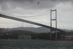Bosphorous bridge and a red ship in Istanbul, Turkey Royalty Free Stock Photography