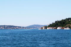 On the Bosphorus. Blue water sky and mountains Royalty Free Stock Photo