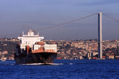 Bosphorus Bridge and Cargo Ship Royalty Free Stock Image