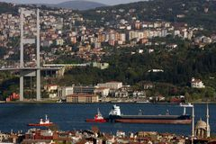 Bosphorus Bridge and Cargo Ship Royalty Free Stock Images