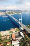 Bosphorus Bridge Istanbul Turkey. Aerial view of Istanbul Bosphorus Bridge and ferry on the sea. Bosphorus Bridge with background of Bosphorus strait on a sunny royalty free stock photo