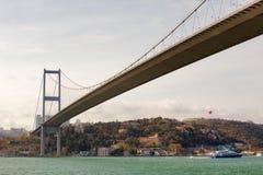 Bosphorus bridge, Istanbul, Turkey. View to Bosphorus bridge from the strait with floating boat, Istanbul, Turkey Royalty Free Stock Photo