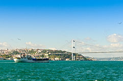 Bosphorus Bridge and a ship Royalty Free Stock Image