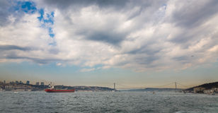 Bosphorus with buildings, bridge and cargo ship, Istanbul Royalty Free Stock Image