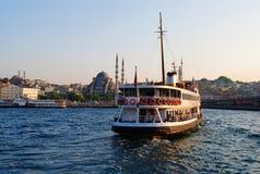 Bosphorus Cruise. At dusk in Istanbul, Turkey royalty free stock photo