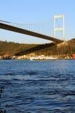 Bosphorus Ferry. Istanbul Turkey. Ferry passing by Bosphorus bridge Stock Images