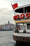 Bosphorus ferry with Galata Tower in the background, Istanbul, Turkey. The aft of a Bosphorus ferry with Galata Tower in the background, Turkish flag flapping in Royalty Free Stock Photography