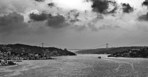 Bosphorus Istanbul. A very spectacular view of Turkey Turkiye Istanbul Bosphorus, with storm clouds. The name of the bridge in the photo is The Bridge of Fatih Stock Image