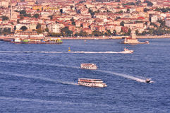Bosphorus and Maiden Tower. Istanbul, with boats, viewed from Galata Tower Royalty Free Stock Image