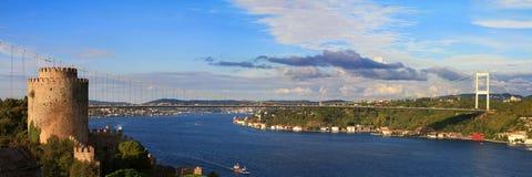 Bosphorus Panorama. Rumelihisari with the Fatih Sultan Mehmet Bridge in the background in Istanbul, Turkey Royalty Free Stock Photo