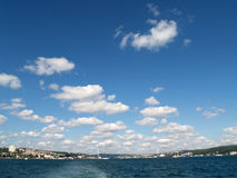 Bosphorus. Sky with small white clouds over the Bosphorus with Istanbul in the background Royalty Free Stock Image