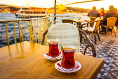 Bosphorus tea. ISTANBUL, TURKEY - october 23, 2014: people are drinking tea in a cafe with Bosphorus bridge view in Istanbul, Turkey. Toned image royalty free stock photos