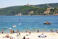 Bosporus beach. People relax on Bosporus beach at Sariyer region in the begining of the summer. June10, 2009 in Rumeli Kavagi, Istanbul Royalty Free Stock Image