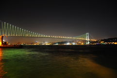 Bosporus bridge. At night with lights in Istanbul, Turkey Royalty Free Stock Photography