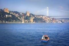 Bosporus bridge and Rumeli Hisar castle in Istanbul Royalty Free Stock Image