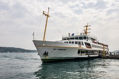 Bosporus and city lines ferry at ortakoy pier with passengers in besiktas,istanbul. stock photos