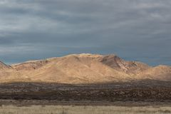 Bosque del Apache view of New Mexico mountain range before darkening skies. Horizontal aspect stock photography