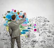 Bosquejos del dibujo del hombre de negocios en la pared Foto de archivo libre de regalías