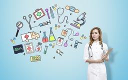 Bosquejos del doctor y de la medicina de la mujer Foto de archivo libre de regalías