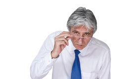 Boss 4. Gray-haired mature man wearing a white shirt and a blue necktie looking attentively Stock Photo