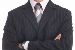 Boss. Upper part of the body with arms crossed dressed in a suit with a tie Stock Photography