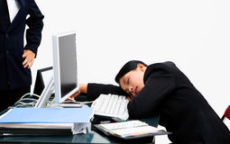 Boss angry at the sleeping secretary. The boss watching the secretary sleeping at working hour with angry pose Stock Photos