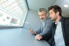 Boss and apprentice. The boss and the apprentice royalty free stock photos