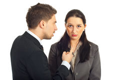 Boss argue employer woman. Nervous boss argue and pointing to a sad employer woman isolated on white background Royalty Free Stock Photo
