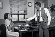 Boss arguing with young secretary in the office. Furious director arguing with young secretary, 1950s vintage office Royalty Free Stock Photography