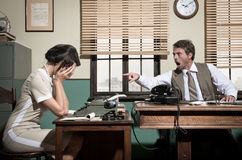 Boss arguing with young secretary in the office Stock Photo