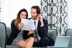 Boss and assistant or in hotel working together Stock Image