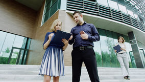 Boss and assistants. Stands near the office building royalty free stock photography