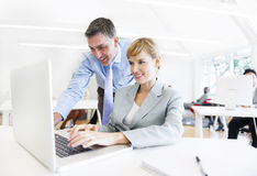 A Boss Assisting his Employee in Front of the Laptop Royalty Free Stock Image
