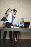 Boss beats an employee, for poor performance Stock Images