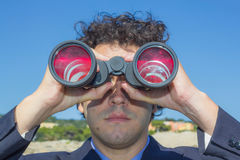 Boss with binoculars Royalty Free Stock Photo