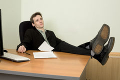 Boss in black suit on a workplace Royalty Free Stock Photo