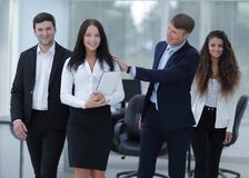 Boss and business team in office. Smiling boss and business team Royalty Free Stock Photos