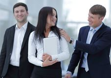 Boss and business team in office. Smiling boss and business team Royalty Free Stock Photo