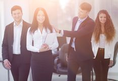 Boss and business team in office. Smiling boss and business team Royalty Free Stock Photography