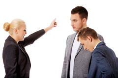 Boss businesswoman screaming at her employees Royalty Free Stock Image