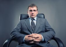 Boss in a chair Royalty Free Stock Images