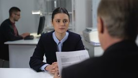 Boss checking female employee work results, probationary period at workplace. Stock footage stock video