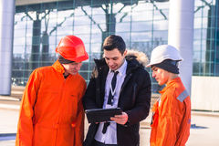 Boss or Chief  instructs young team of  young engineers Royalty Free Stock Photography
